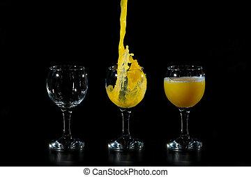 Three glass cups of orange juice