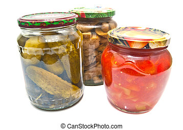 THREE GLASS JARS WITH MARINATED VEGETABLES