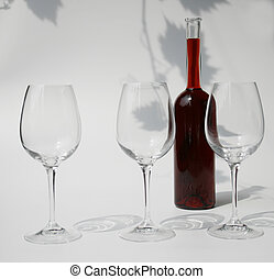 three glasses and a bottle of wine