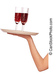 A waiter takes a glass of champaigne from a tray with three glasses