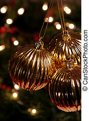 Three Gold Balls - Three Golden Xmas Baubles hanging in ...