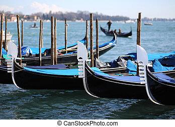 three gondolas in Venice in Italy