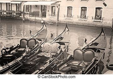 three gondolas in Venice, Italy