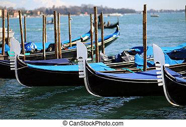 three gondolas near St. Mark's square in Venice