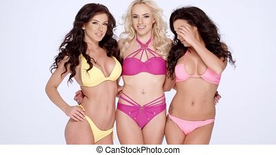 Three gorgeous shapely women in bikinis