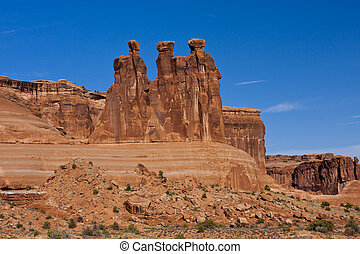 Three Gossips is a natural rock feature Arches National Park near Moab, Utah.