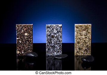 Three granite samples of kitchen countertops with decoration