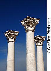 Three greek pillars - Three ancient greek pillars against a...