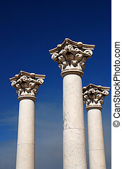 Three greek pillars - Three ancient greek pillars against a...