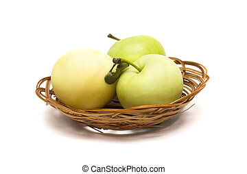 Three green apples in a basket on a white background
