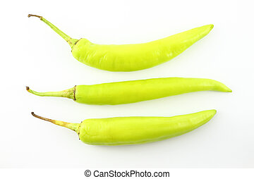 Three green chili peppers on white background.