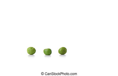 Three green peas isolated on white. Copy space