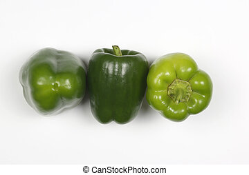 three green peppers on white background