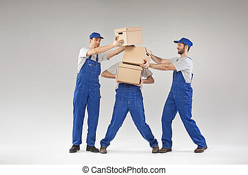 Three guys holding paper boxes