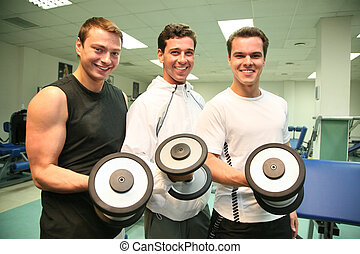 three gym men with dumbbells