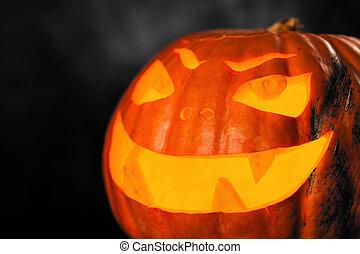 Three halloween Jack O' Lantern pumpkins