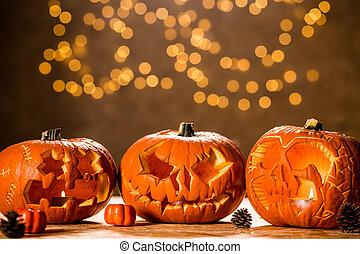 Three Halloween pumpkin lanterns