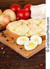 Three halves of quail eggs on chopping board