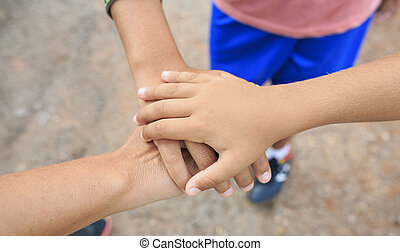 Three hand together