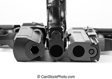 Three handguns. Beretta 92, Desert Eagle and M23 Double...