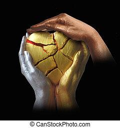 Three hands in bronze colors with a broken heart