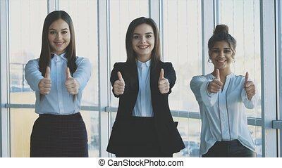 Three hands of girls' businessmen close their hands,...