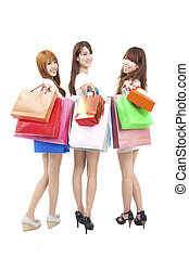 three happy asian shopping woman