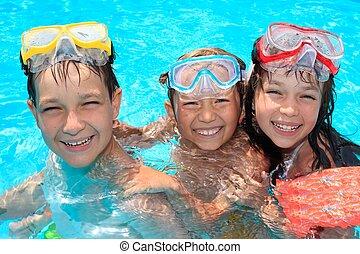 Three happy children in pool