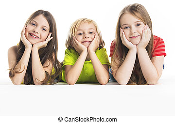 Three happy children laying down, isolated on white...