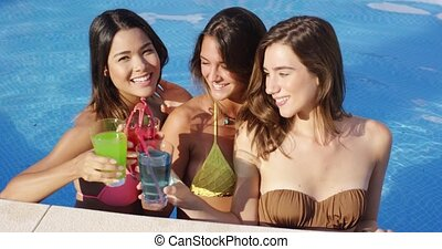 Three happy female friends celebrating