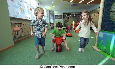 Three Happy Friends - Tracking shot of three kids...