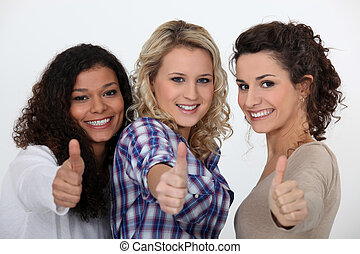 Three happy girls with thumbs up