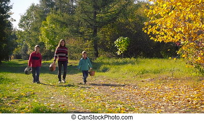 Three happy kids walking in autumn forest for mushrooms -...