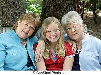 Three Happy Ladies - Three generations - a little girl, her...