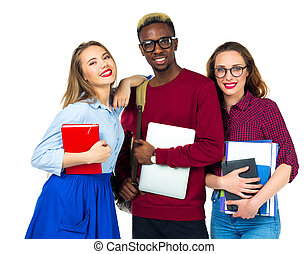 Three happy students standing and smiling with books