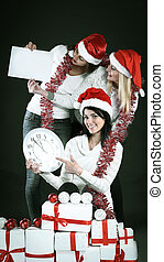 three happy women in costume of Santa Claus with clock, and Chris
