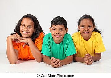Three happy young school friends