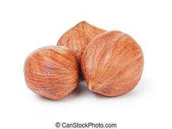 three hazelnut kernels, isolated on white background