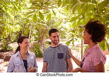 Three healthy friends laughing and chatting