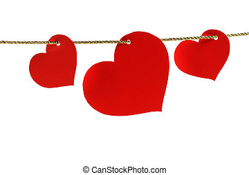 three heart-shaped cards hanging on a golden twine