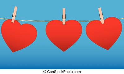 Three hearts for Valentine's day hanging on a rope