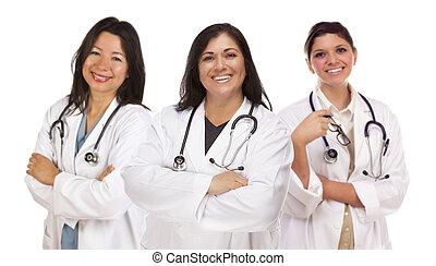 Three Hispanic Female Doctors or Nurses on White