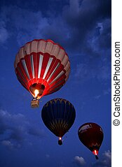 hot air balloons flying by night
