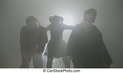 Three hungry scary zombies out in fog to hunt for day of the...