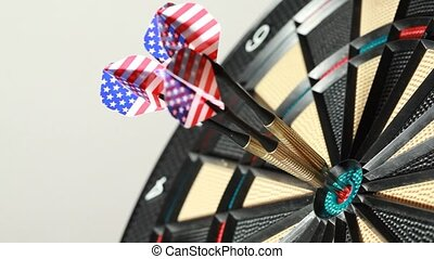 Three ideal hits in red point by darts with american flag, side view
