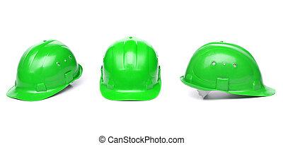 Three identical green hard hat.