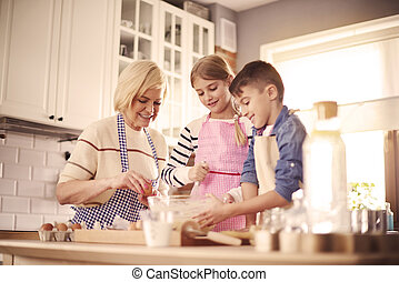 Three intent chefs in the domestic kitchen