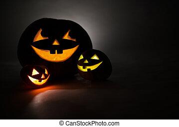 Three jack-o-Lantern at dark