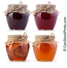 Three jar of jam and honey on white background