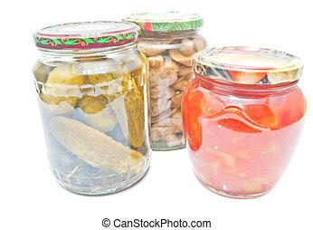 three jars with marinated vegetables